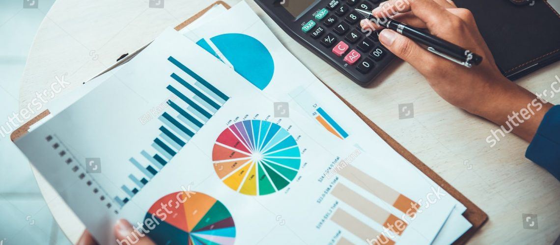 stock-photo-business-expert-working-on-investment-analysis-data-693080233
